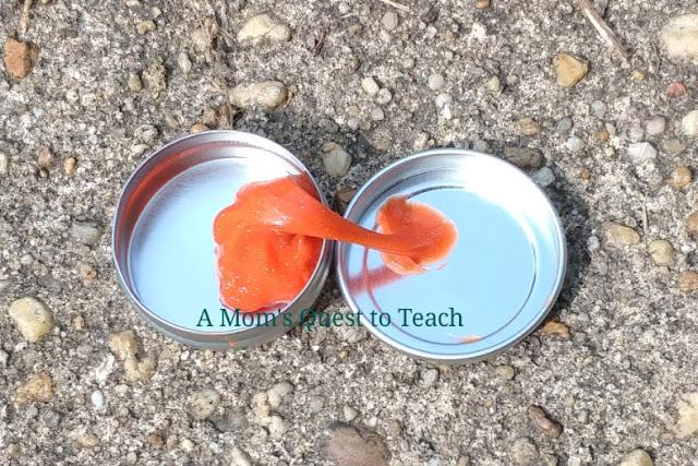 Orange sparkle putty in tin (photo outside)