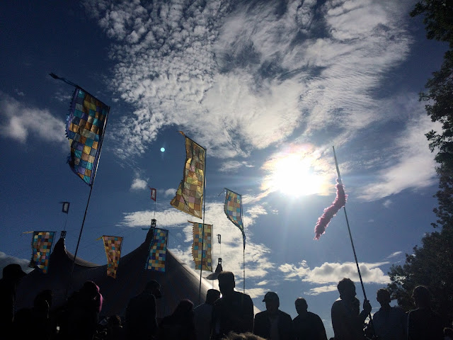 Flags at Glastonbury in the sun