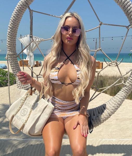 Charley Hull posing in a bikini top