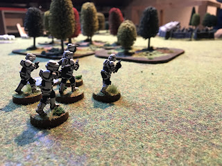 Scout troopers race forward to find a good position to fight from