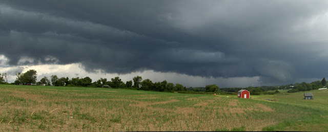 storm clouds over corn field