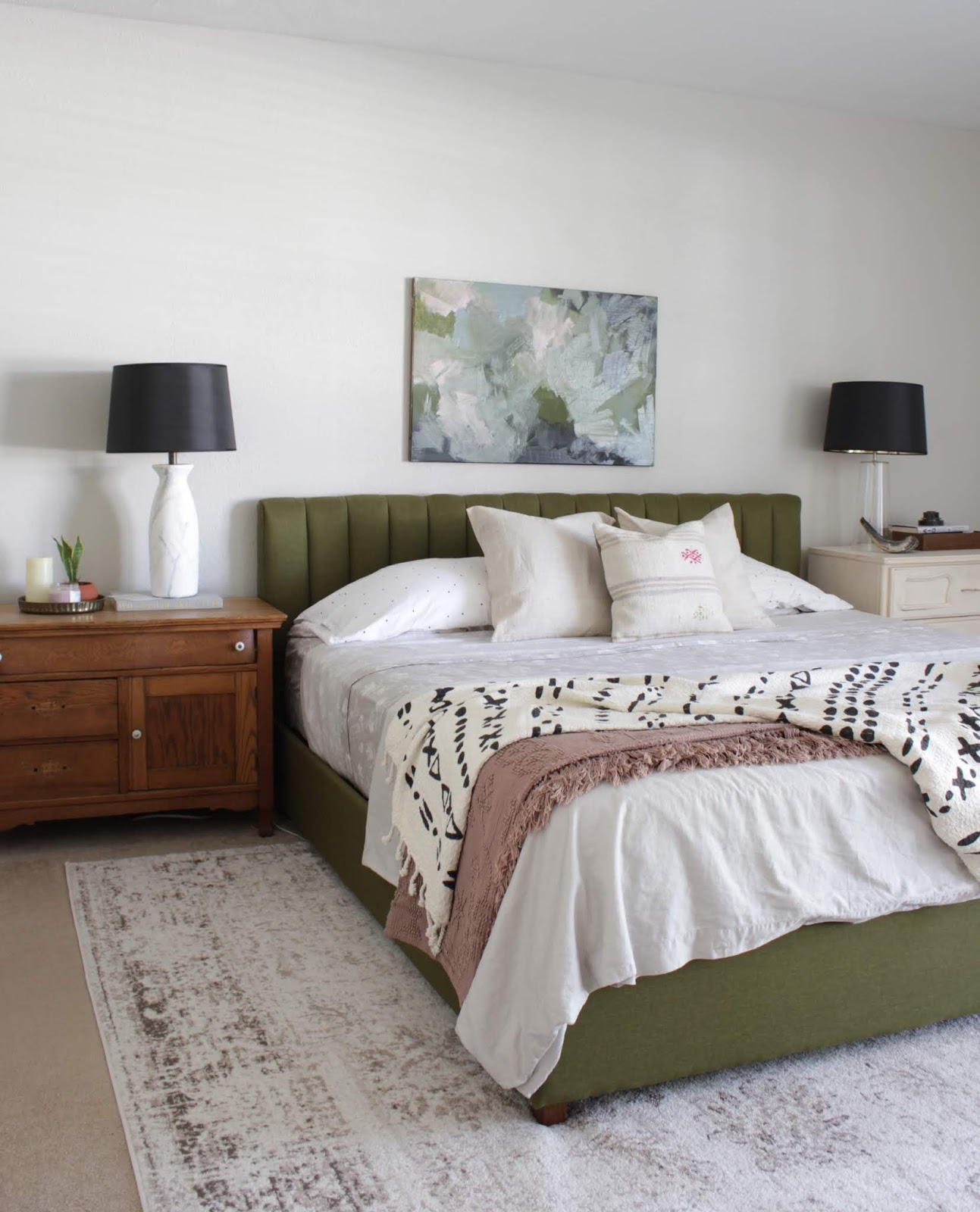 We've lived in our house a whole year!! Check out the tour and a round up of projects I've done. It's been great! | House Homemade Upholstered Green Bed
