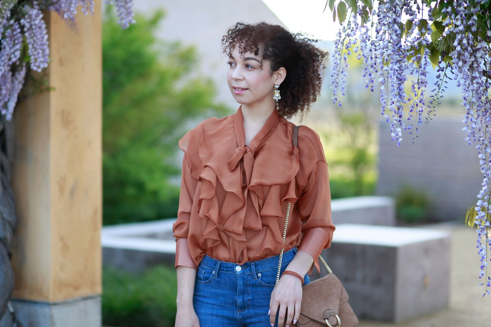 girl with natural curls wearing ruffle blouse top