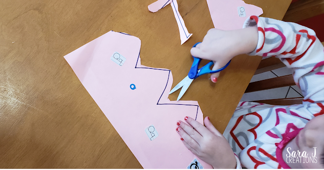 Making and cutting a crown for fine motor practice all about queens and the letter Q