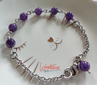 Amethyst wire wrapped bracelet on a cat shaped white plate