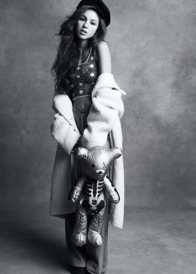 Singer Olivia Rodrigo wears Prada coat, Guess Vintage pants, and Tiffany & Co. Necklace
