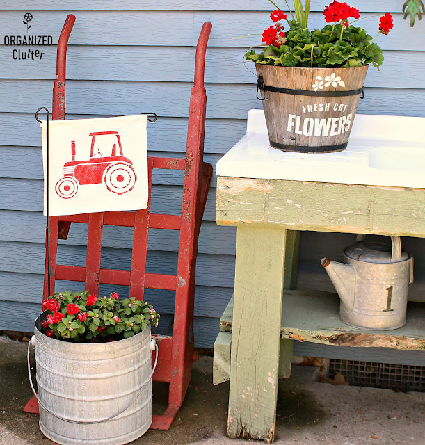 Decorating the Junk Garden Potting Bench  #oldsignstencils #stencils #containergarden #flowergarden #galvanized #farmhouse #junkgarden #gardenjunk #rusticgarden #geraniums #annuals