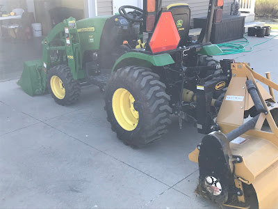 Woodward Acres John Deere 2025r with Tarter 5' Tiller