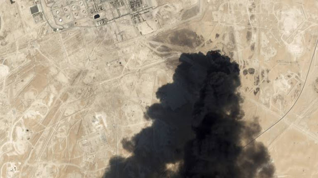 Image Attribute: Satellite image from Planet Labs Inc. shows thick black smoke rising from Saudi Aramco's Abqaiq facility in Buqyaq / Dated: September 14, 2019.