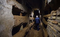 Niches held the shrouded bodies of early Christians in the catacomb of Santa Domitilla, in central Rome, on May 30, 2017 [Credit: AFP/Andreas Solaro]