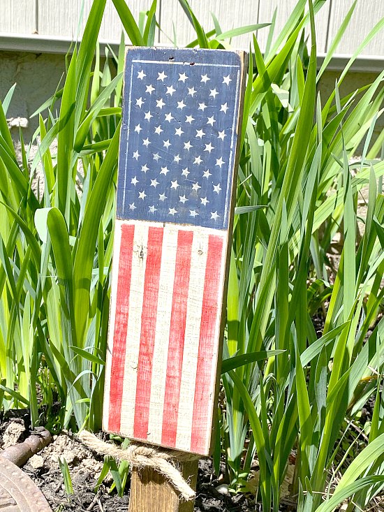 American flag stenciled plant stake in the garden