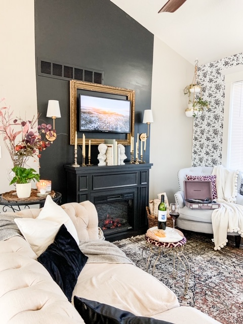 diy fireplace with faux sconces