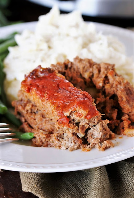 Slow Cooker Meatloaf image ~ whip up the classic comfort of meatloaf with slow cooker convenience.