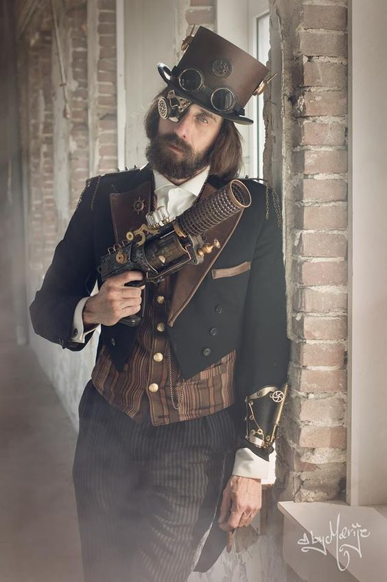 Steampunk man wearing black and brown formal menswear (top hat, waistcoat, tailcoat, etc) and holding a steampunk gun