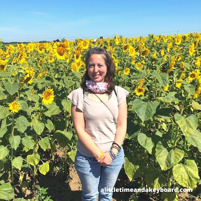 Standing near stunning sunflowers at Von Bergen's Sunflower Maze.