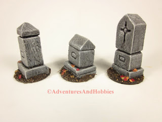 Left side view of three graveyard monuments for 25 to 28mm scale wargames.