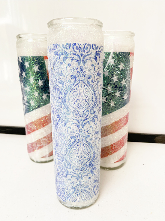 American flag and a blue glittered candle