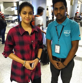 Keerthy Suresh with Cute Smile with a Fan