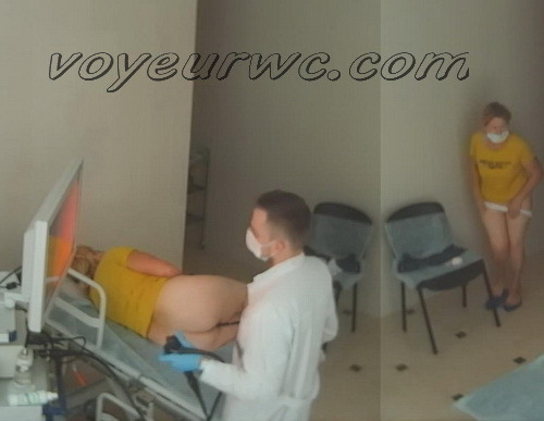 A patient lies on their side while a gastroenterologist inserts a colonoscope (Female colonoscopy SpyCam 06-07)