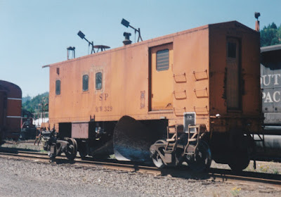 Southern Pacific Flanger SPMW #329 in Oakridge, Oregon, on July 18, 1997