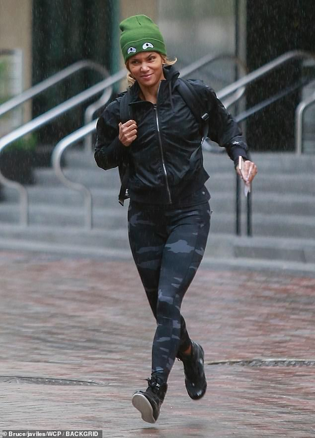 2c30ccdf2e0da StarrLab  Halle Berry in green and skintight leggings as she dashes through  the rain in Los Angeles