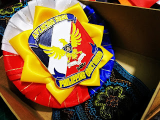 Philippine flag color palette design for rosette ribbon lei given to officials and delegates