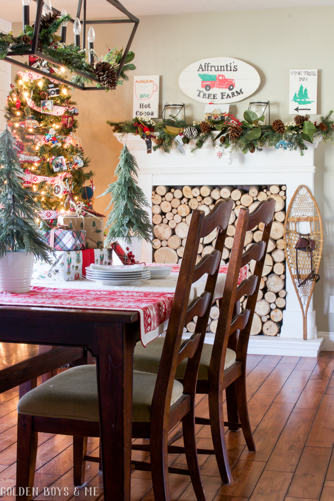 Christmas dining room with DIY faux fireplace and lantern lighting - Golden Boys and Me Holiday Home Tour 2017