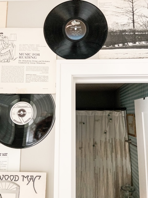 records hanging on the wall as decor