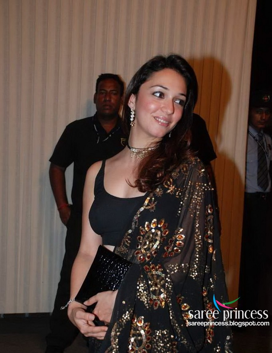 Bollywood actress Nauheed Cyrusi shocking exposure in a backless black saree