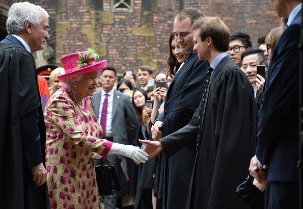 Queen Elizabeth wore a floral satin dress, pink coat and pink hat for visit National Institute of Agricultural Botany