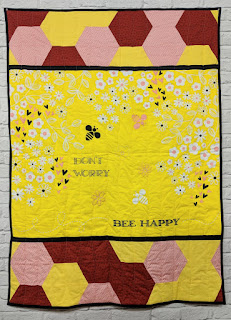 don't worry bee happy panel hexagon quilt