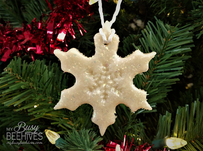 snowflake ornament with snowflake imprint on tree