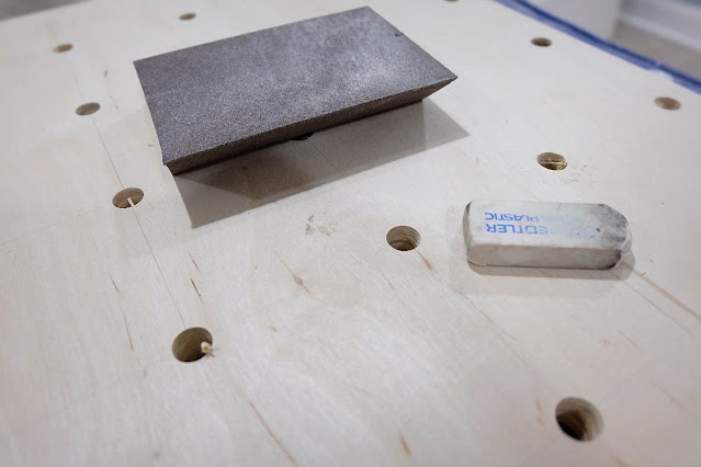 erasing pencil lines on plywood pegboard