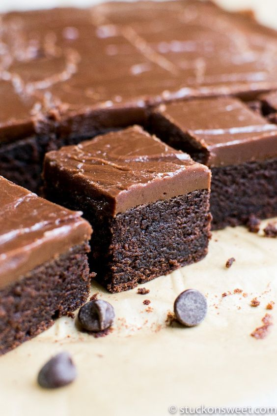 A thick, moist and fudgy brownie topped with a fudge like frosting.