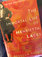The Immortal Life of Henrietta Lacks, by Rebecca Skloot, superimposed on Intermediate Physics for Medicine and Biology.