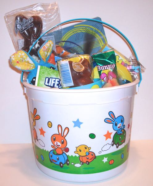 Oryans village candy blog easter baskets for kids the easter basket for toddlers boys comes with a stuffed bunny a plastic easter cup and a story book you also get a box of easter cookies fruit snacks negle Images