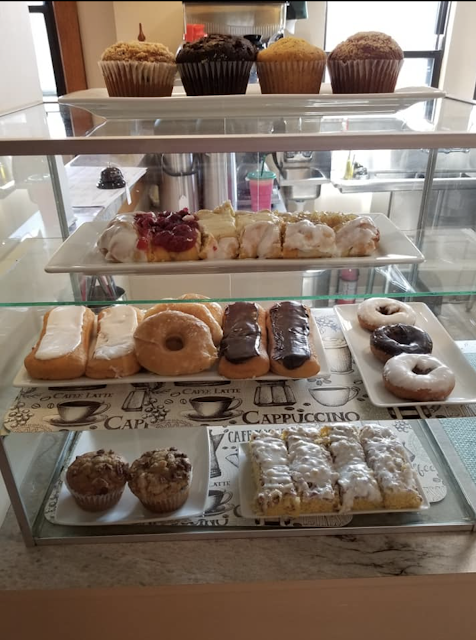 color photo of array of donuts and pastries Grafton Illinois coffee antiques shop Lightkeepers Coffee 101 E Main St Sears Vallonia