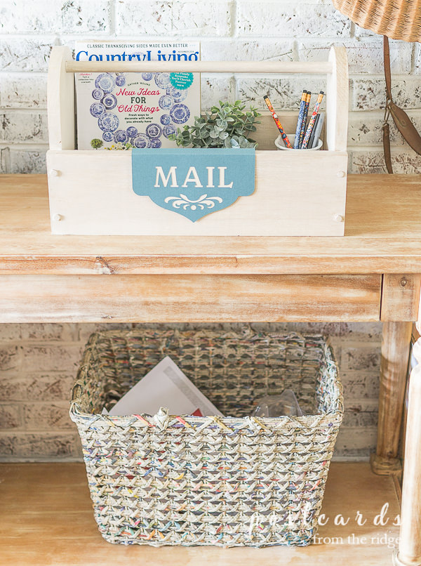 wooden toolbox mail organizer with magazines, pencil, and a label created with cricut