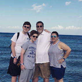 A photo of David Brodosi and his family on the beach of Cozumel