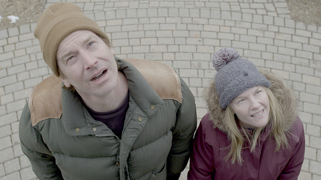 rob huebel and rachel harris gawk at the sky