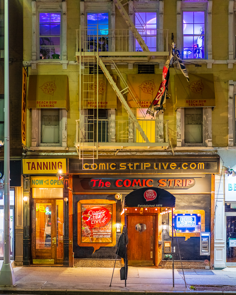 a photo of a new york city comedy club at night