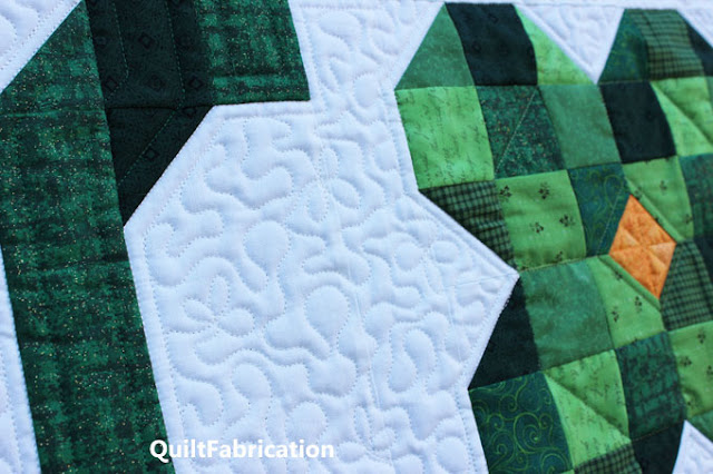 three leaf clovers mixed in with stipple quilting