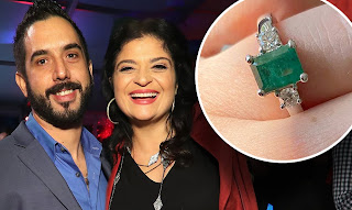Alex Guarnaschelli with her fiance Michael Castellon with engagement ring photo attached