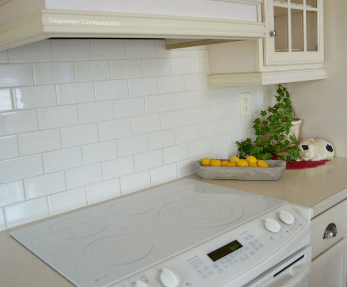 White glass electric stove in a white kitchen
