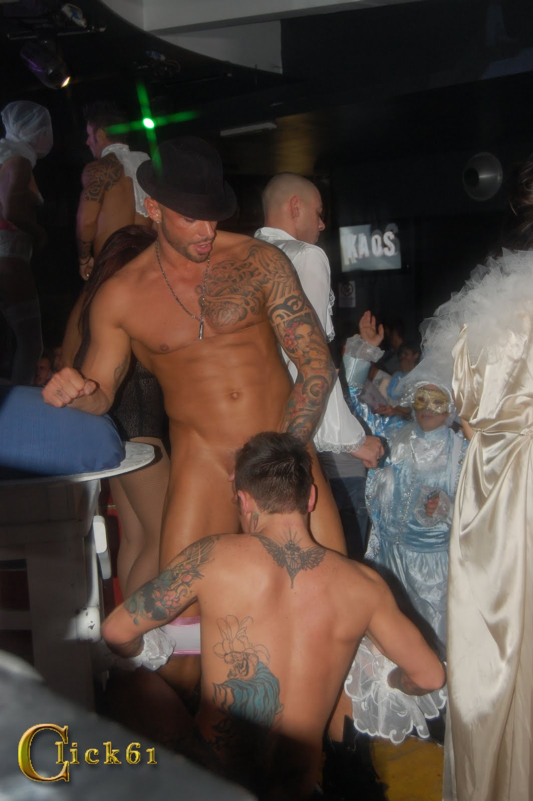 performing males Naked guy sucks off another in the club