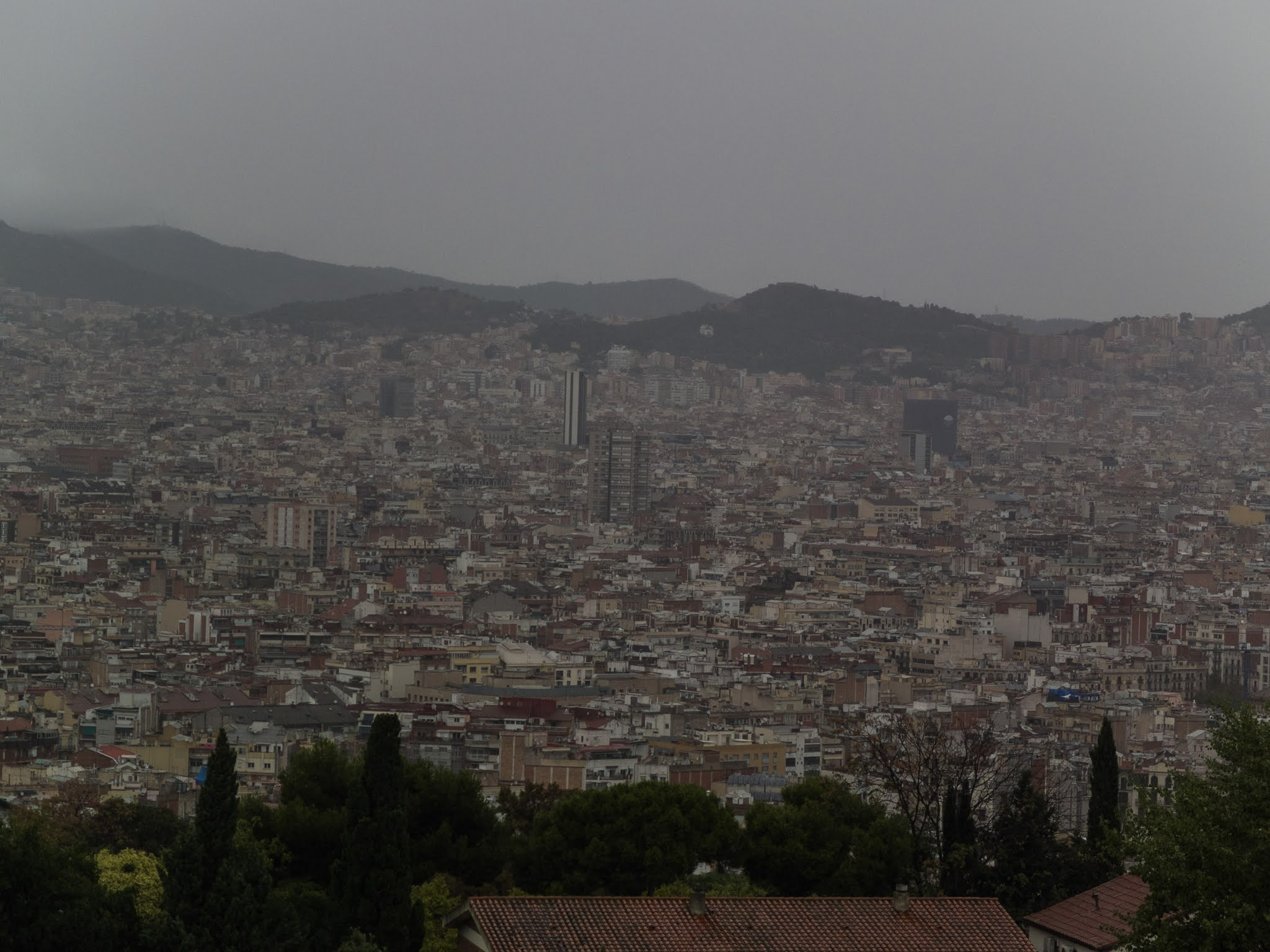 View of the city of Barcelona on a rainy day.