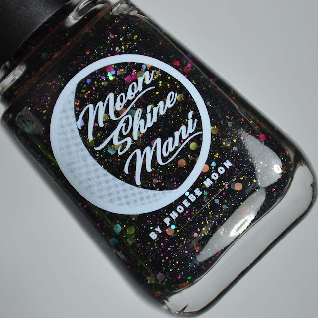 black nail polish with rainbow glitter in a bottle
