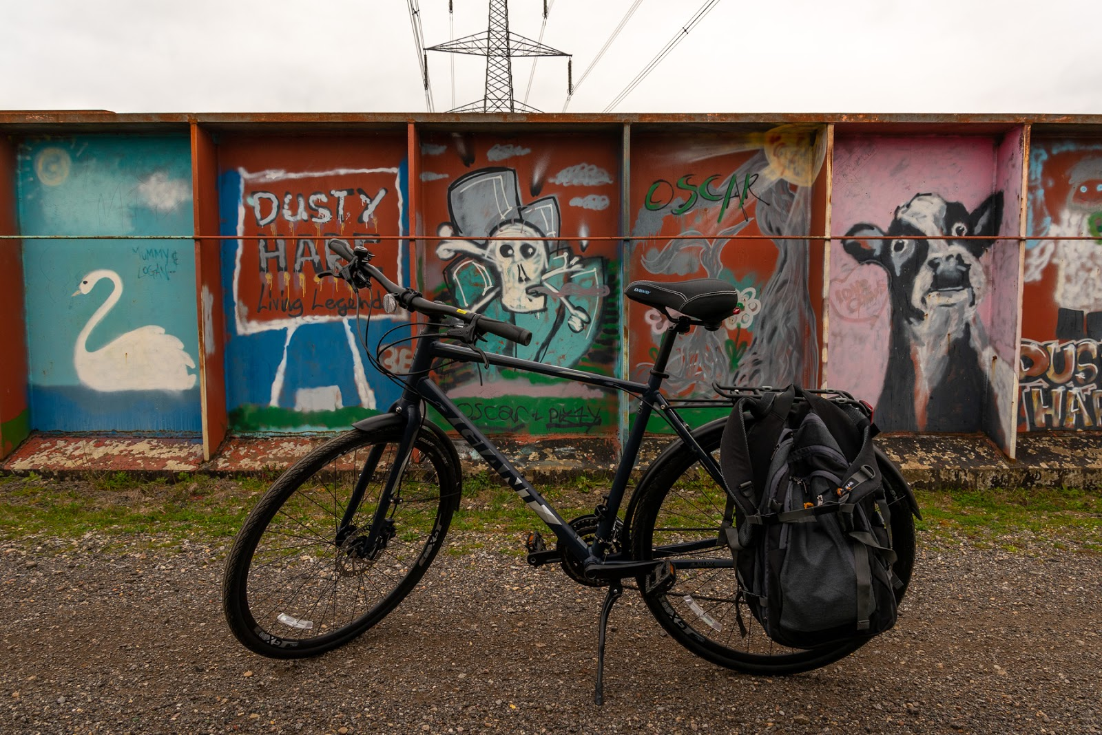 My bike in front of graffiti