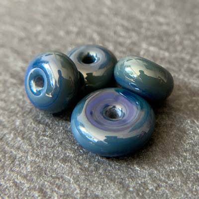 Handmade lampwork glass beads by Laura Sparling made with CiM Montezuma