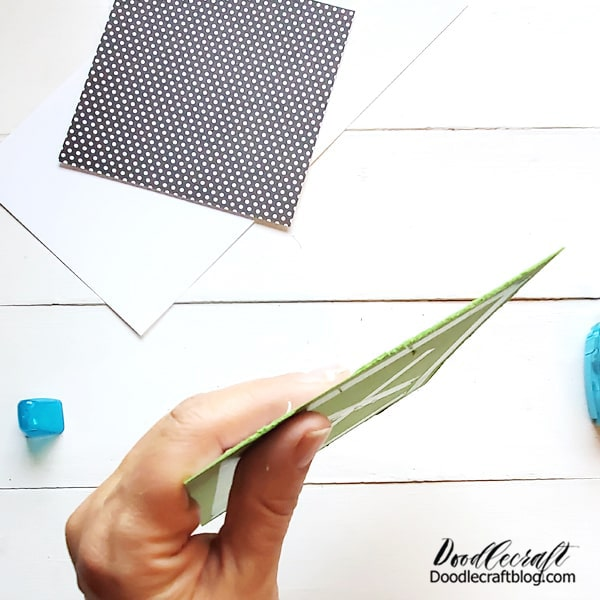Step 4: Card Making! Now use a blade around the edge of the paper to rough them up slightly. Then tape the image to a piece of cardstock.